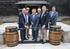 Tennessee Governor Bill Haslam, state officials, Master Distiller Jeff Arnett and representatives from Jack Daniel's celebrate the opening of the enhanced visitor experience at the Jack Daniel Distillery.